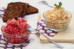 Sauerkraut of two types. With carrots and with carrots, beet and blackcurrant Stock Image