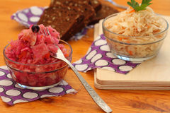 Sauerkraut of two types. With carrots and with carrots, beet and blackcurrant Royalty Free Stock Photos