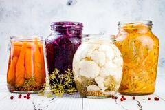 Sauerkraut variety preserving jars. Homemade red cabbage beetroot kraut, turmeric yellow kraut, marinated cauliflower and carrots stock photos