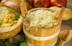 Sauerkraut in a wooden barrel royalty free stock photos