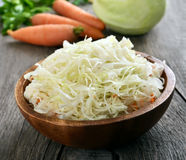 Sauerkraut in wooden bowl Royalty Free Stock Photography