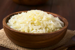 Sauerkraut. In wooden bowl, photographed with natural light (Selective Focus, Focus one third into the Stock Image