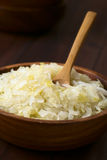 Sauerkraut. In wooden bowl, photographed with natural light (Selective Focus, Focus one third into the Royalty Free Stock Photos