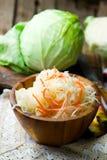 Sauerkraut in a wooden bowl Stock Photo