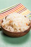 Sauerkraut. In a wooden bowl on the table Stock Photography