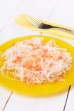 Sauerkraut on yellow plate Stock Image