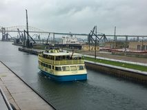 Soo Locks - boat. SAULT STE. MARIE, MI / USA - MAY 28, 2017: Soo Locks Boat Tour travels through the Soo Locks royalty free stock images