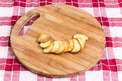Saulty crispy little toast breads on the wooden board Royalty Free Stock Photo