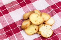 Saulty crispy little toast breads on the wooden board Stock Image