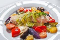 Saumons avec les légumes rôtis Photo libre de droits
