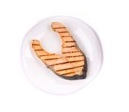 Saumons rôtis d'un plat Photographie stock libre de droits