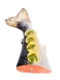 Saumons sur un fond blanc. queue Photo libre de droits