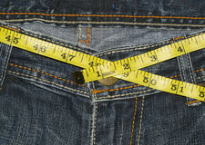 Saun. Jeans with centimetr in weight loss concept Royalty Free Stock Images