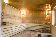 Sauna. With furnish from a natural tree and stones for steam creation Stock Photos