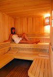 Sauna. Beautiful young woman in sauna Stock Images