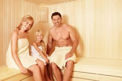 In the sauna. Happy family in the sauna Royalty Free Stock Image