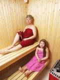 Sauna. Mother and daughter sitting in a sauna relaxing Stock Images