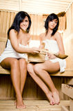 Sauna. Two young women relaxing in a sauna Royalty Free Stock Photos