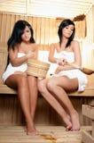 Sauna. Two young women relaxing in a sauna Stock Photo
