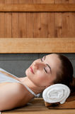 Sauna. Closeup of beautiful lady relaxing at sauna in a spa center royalty free stock image