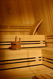 Sauna. Wooden sauna interior with bucket for throwing water Royalty Free Stock Image