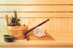 Sauna accessories. Bucket with birch broom, towel and ladle Royalty Free Stock Photo