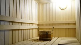 Sauna accessories are in the interior of the steam room. The interior of the sauna. Sauna from linden. stock image