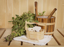 Sauna accessories. Sauna ready accessories - broom, tub, towel and scoop Royalty Free Stock Photography