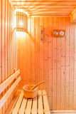 Sauna accessories in sauna room, wooden bucket place on bench an Stock Photos