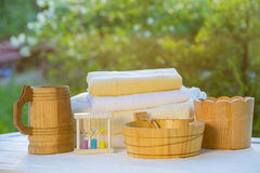 Sauna accessories. Wooden sauna accessories, sand glass and towels Royalty Free Stock Photo