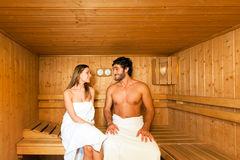 Sauna bath in a steam room. Couple having a sauna bath in a steam room royalty free stock images