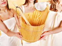 Sauna bucket  holding by group woman. Stock Photography
