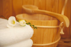 Sauna. Bucket, ladle and towel in stock image
