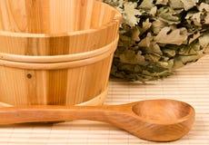 Sauna bucket and wooden spoon Stock Images