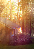 Sauna cottage in midsummer night near lake Stock Photos