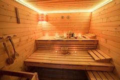 Sauna de madera en la luz de una vela Fotos de archivo libres de regalías