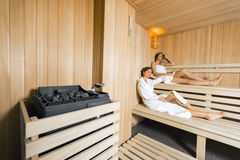 Sauna heater and girls relaxing royalty free stock image