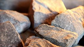 Sauna hot stones stock footage