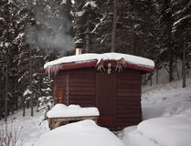 Sauna hut in winter forest Stock Photos