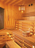 Sauna inside. Wooden sauna inside with bucket and scoop Stock Image