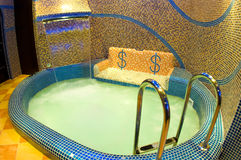 Sauna interior. Mosaic pool with bench in sauna interior royalty free stock photography