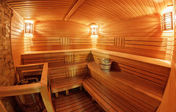 Sauna. Light wooden sauna with bench Royalty Free Stock Photography