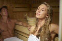 Sauna. Man and women in the sauna interior Royalty Free Stock Photos