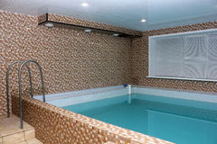 Sauna pool with blue water interior Royalty Free Stock Photos