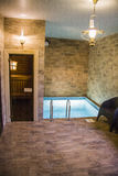 Sauna pool. With waterfall and palms indoor Royalty Free Stock Photo
