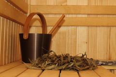 Sauna room. Bucket with a bucket, broom and eucalyptus Royalty Free Stock Images