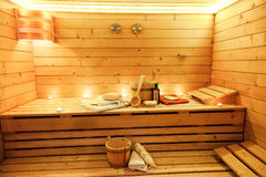Sauna room with traditional sauna accessories. Sauna interior with traditional sauna accessories Royalty Free Stock Photo