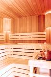Sauna room. Wooden sauna interior with copper bucket. Bath accessories. Finnish sauna of small size. royalty free stock images