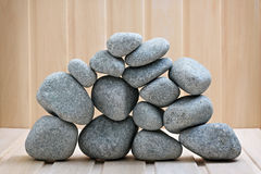 Sauna stones. Stacked on a wooden surface. Stock Photography