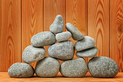 Sauna stones. Stacked on a wooden surface. Stock Photo
